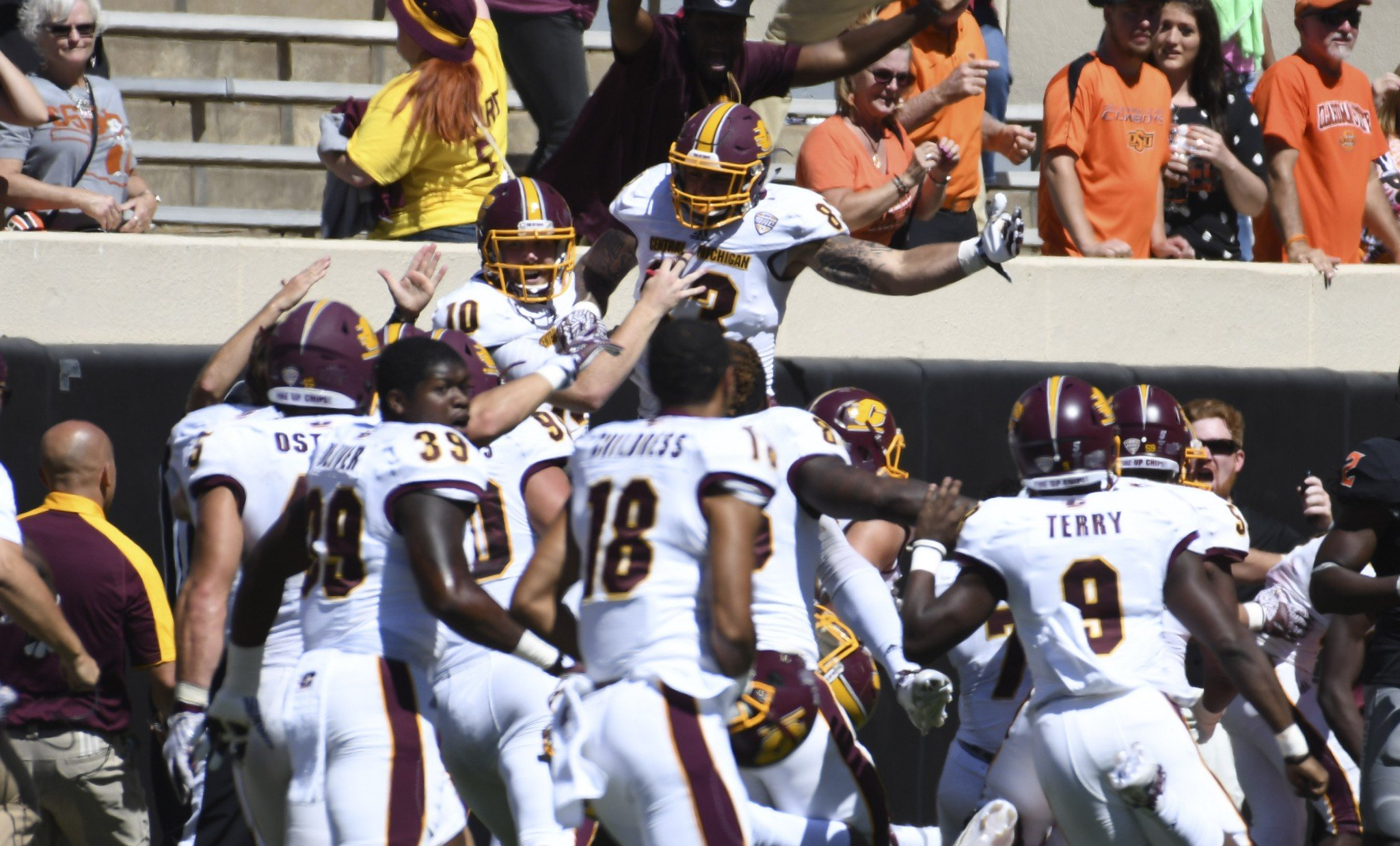 Central Michigan players celebrate after beating Oklahoma State on a last-second Hail Mary. (Getty)
