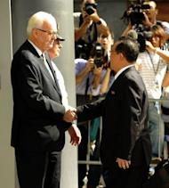 """US Ambassador Stephen Bosworth, the Obama administration's top envoy on North Korean affairs, greets North Korean Vice Foreign Minister Kim Kye-Gwan (R) at the US Mission to the United Nations in New York. The United States on Thursday pressed North Korea to take """"concrete and irreversible"""" steps to give up its nuclear arsenal at talks on how to improve hostile relations"""
