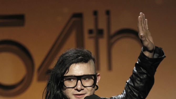 FILE - In this Feb. 12, 2012, file photo, Skrillex accepts the award for best remixed recording non-classical, for Cinema, at the 54th annual GRAMMY Awards pre-show in Los Angeles. Skrillex, whose sound is a mix of electronic, grunge and dubstep, was a fairly unknown Los Angeles DJ-producer before winning three Grammy Awards this year. (AP Photo/Matt Sayles, file)