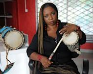Talking drummer Aralola Olamuyiwa, popularly known as Ara, plays the talking drum during a rehearsal in Lagoson. The talking drum is a long way from dying, having now been incorporated into not only traditional music, but also African hip-hop and the songs of global stars such as Erykah Badu