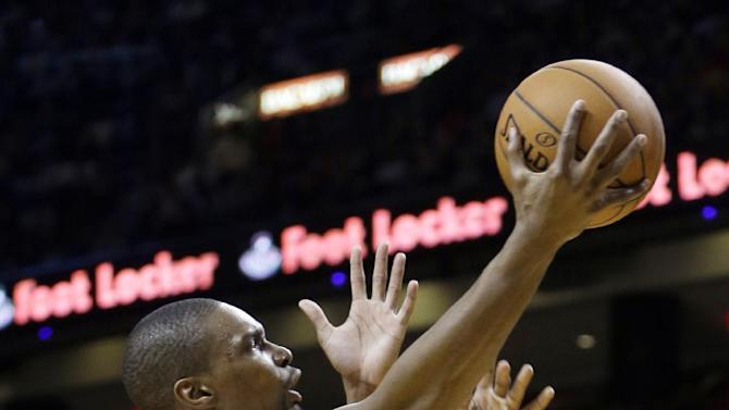 Miami Heat forward Chris Bosh (1) goes to the basket against the Denver Nuggets during the first half of an NBA basketball game in Miami, Friday, March 14, 2014. (AP Photo/Alan Diaz)