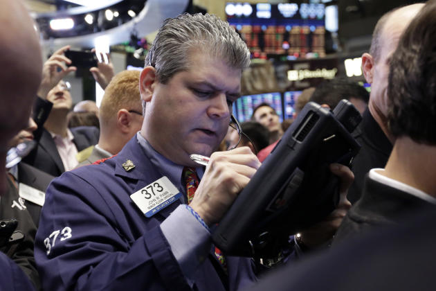 Trader John Panin works on the floor of the New York Stock Exchange, Wednesday, April 1, 2015. U.S. stocks moved lower in early trading Wednesday, extending losses from the day before. A report indica