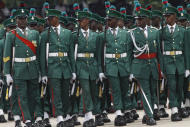 Nigeria soldiers match during the inauguration ceremony of Nigeria President Goodluck Jonathan at the main parade ground in Nigeria's capital of Abuja, Sunday, May 29, 2011. Jonathan was sworn in Sunday for a full four-year term as president of Nigeria and is now faced with the challenge of uniting a country that saw deadly postelection violence despite what observers called the fairest vote in over a decade.