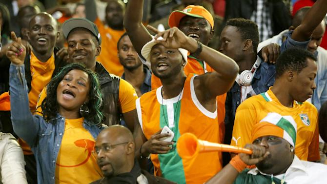 Supporters of Ivory Coast's soccer team cheer after the team scored a goal in the World Cup 2014 qualifying match between Ivory Coast and Senegal at Mohammed V stadium in Casablanca, Morocco, Saturday Nov. 16, 2013. Ivory Coast qualified for the World Cup tournament by beating Senegal 4-2 on aggregate in a playoff for next year's finals in Brazil after a 1-1 draw