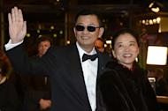 Chinese director Wong Kar Wai (L) and his wife, Esther, arrive for the opening ceremony of the Berlinale film festival in Berlin on February 7, 2013. Wai will join one of the art world's most exclusive clubs on Sunday when he is appointed a Commander of France's Order of Arts and Letters