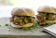 This May 2, 2011 photo shows sesame pulled pork sandwiches in Concord, N.H. Sprinkle each serving of pulled pork with sesame seeds and scallions before serving. (AP Photo/Matthew Mead)