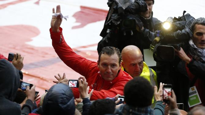 Belgium's soccer team coach Marc Wilmots waves to supporters during a training session in Brussels