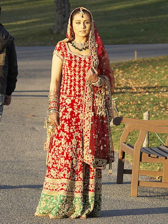 Images via : iDiva.comRani Mukherji plays the beautiful bride who is contemplating about her marriage on her wedding day in the film Kabhi Alvida Na Kehna. Her outfit is a typical Indian bridal wear i