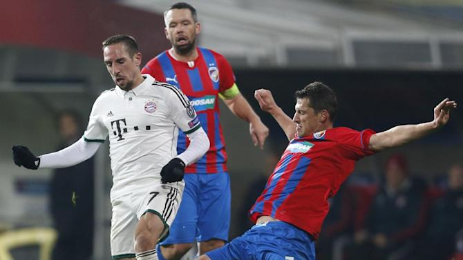 Marian Cisovsky, right, of Viktoria Pilsen challenges Franck Ribery, left, of Bayern Munich during their Champions League Group D soccer match between Viktoria Pilsen and Bayern Munich in Pilsen, Czech Republic, Tuesday, Nov. 5, 2013