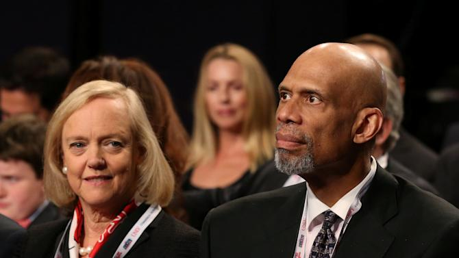 Hewlett Packard Enterprise's Whitman and basketball hall of famer Abdul-Jabbar sit together before the third and final 2016 presidential campaign debate in Las Vegas