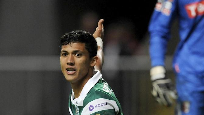 Sporting's Fredy Montero, from Colombia, gestures while holding the ball during the team's Portuguese League soccer match against Sporting Braga at the Municipal Stadium, in Braga, Portugal, Saturday Sept. 26, 2013. Montero scored once in Sporting's 2-1 victory