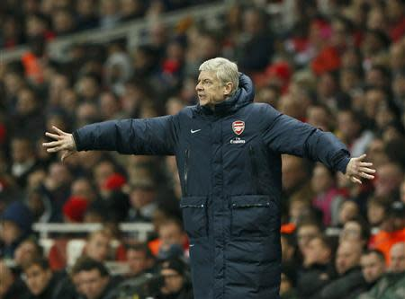 Arsenal manager Arsene Wenger instructs his team during their English Premier League soccer match against Swansea City at the Emirates stadium in London