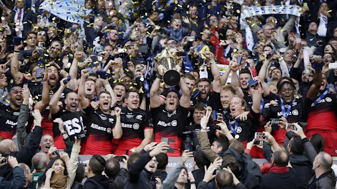 Saracens' Brad Barritt lifts the trophy as he celebrates winning the European Rugby Champions Cup Final with teammates