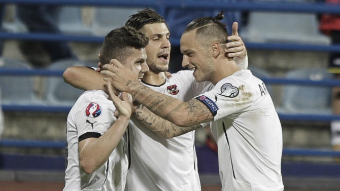 Austria's Sabitzer celebraes with teammates Alexander and Arnautovic after scoring a goal during their Euro 2016 qualifying soccer match in Podgorica