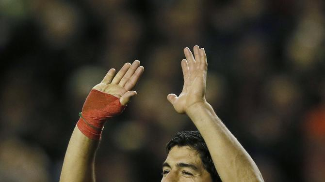 Liverpool's Suarez celebrates after scoring during their English Premier League soccer match against West Ham United at Anfield in Liverpool