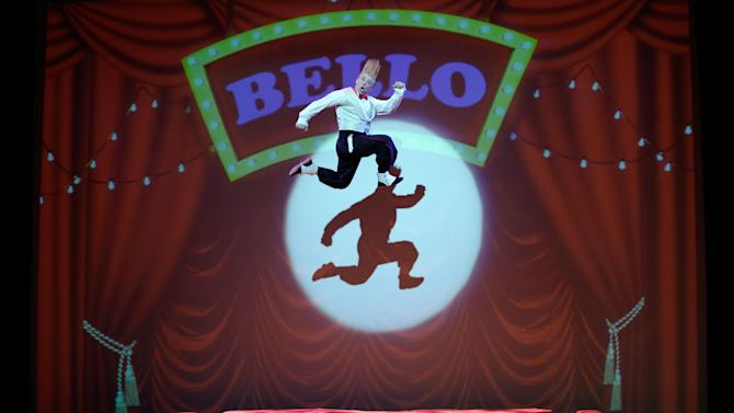 "This March 23, 2013 photo shows performer Bello Nock jumping on a trampoline as he performs during his ""Bello Mania"" show at the New Victory Theater in New York. Nock, a seventh-generation circus performer, is never offstage during the 90-minute performance, which combines slapstick clowning with death-defying aerial stunts. He performs through March 31 at the New Victory before moving on to the Canadian side of Niagara Falls and then a 10-week stint at the Beau Rivage Casino in Biloxi, Miss.   (AP Photo/Richard Drew)"