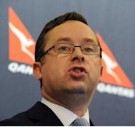 Qantas chief Alan Joyce (pictured in May) dismissed the need to raise fresh equity on Tuesday but confirmed the airline had formed a key management group to deal with any possible takeover bids that emerge
