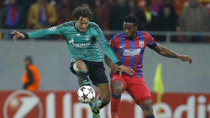 In this Nov. 26, 2013, file photo, Schalke's Jermaine Jones, left, controls the ball ahead of Bucharest's Fernando Varela during their Champions League soccer match at the National Arena in Bucharest, Romania. Jones, an American midfielder, has been loaned to the Turkish club Besiktas from Schalke for the rest of the season after telling the Bundesliga team he wanted a move before the winter transfer window closes Friday, Jan. 31, 2014