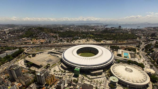 In this photo released by Portal da Copa 2014, an aerial view of the Maracana stadium, in Rio de Janeiro, Brazil, October, 2013. The draw for the 2014 World Cup finals takes place Friday Dec. 6, 2013 near Salvador, Brazil. The 32 teams will be drawn into eight groups of four. The top two in each group will progress to the knockout stages. Twelve stadiums in twelve cities will host matches