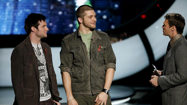 Blake Lewis and Chris Richardson wait to hear who is eliminated on sixth season of American Idol.