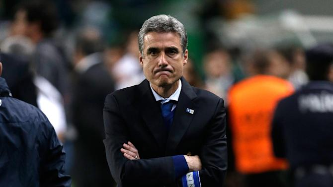 Porto's coach Luis Castro waits for the start of their Portuguese league soccer match with Sporting Sunday, March 16, 2014, at Sporting's Alvalade stadium in Lisbon. Sporting won 1-0