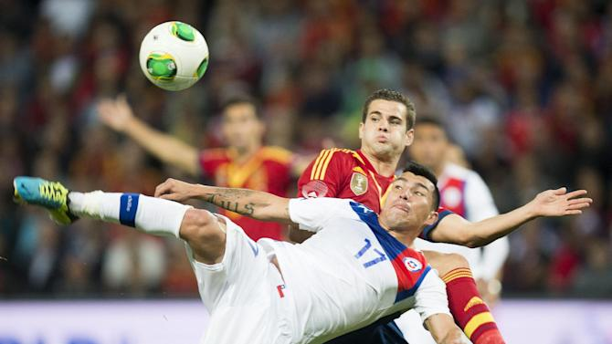 "Spain's  Jose Ignacio Fernandez ""Nacho"", back, challenges for the ball with Chile's Gary Medel, front, during a friendly soccer match between Spain and Chile at the Stade de Geneve stadium, in Geneva, Switzerland, Tuesday, September 10, 2013"