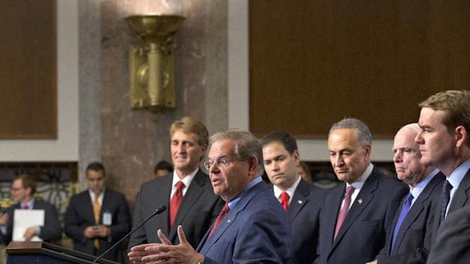 "Foreign Relations Committee Chairman Sen. Robert Menendez, D-N.J., at podium, about immigration reform legislation outlined by the Senate's bipartisan ""Gang of Eight"" Thursday, April 18, 2013, during a news conference on Capitol Hill in Washington. From left are Sen. Jeff Flake, R-Ariz., Menendez, Sen. Marco Rubio, R-Fla., Sen. Charles Schumer, D-N.Y., Sen. John McCain, R-Ariz., and Sen. Michael Bennet, D-Colo. (AP Photo/J. Scott Applewhite)"