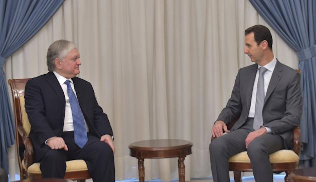 Syria's President Bashar al-Assad meets with Armenian Foreign Minister Edward Nalbandian in this handout provided by SANA
