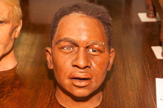 This waxwork, apparently of football legend Pele, is one of many celebrity 'lookalikes' up for auction (SWNS)