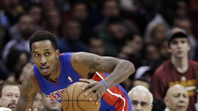 Detroit Pistons' Brandon Jennings races upcourt after stealing the ball from Cleveland Cavaliers' Kyrie Irving, bottom right, during the third quarter of an NBA basketball game Monday, Dec. 23, 2013, in Cleveland. The Pistons won 115-92