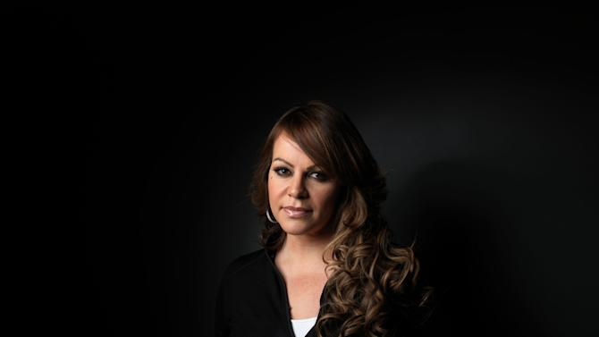 """FILE - In this Jan. 22, 2012, file photo, Jenni Rivera, from the film """"Filly Brown,"""" poses for a portrait during the 2012 Sundance Film Festival in Park City, Utah. The wreckage of a small plane believed to be carrying Mexican-American music superstar Jenni Rivera was found in northern Mexico on Sunday, Dec. 9, 2012, and there are no apparent survivors, authorities said. (AP Photo/Victoria Will, file)"""