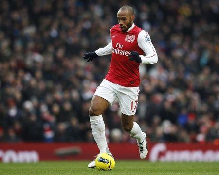 Arsenal's Thierry Henry runs with the ball during their English Premier League soccer match against Blackburn Rovers in London