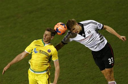 Fulham's Burn challenges Sheffield United's Porter during their English FA Cup soccer match at Craven Cottage in London