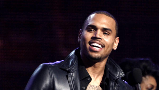 """FILE - In this Feb. 12, 2012 file photo, Chris Brown accepts the award for best R&B album for """"F.A.M.E."""" during the 54th annual Grammy Awards in Los Angeles. A Los Angeles judge on Tuesday July 10, 2012 ordered an audit of Brown's community service hours after a prosecutor said there appeared to be discrepancies in the records about how many hours and days he has performed. Brown was ordered to appear at the next hearing, scheduled for Aug. 21, 2012. (AP Photo/Matt Sayles, File)"""