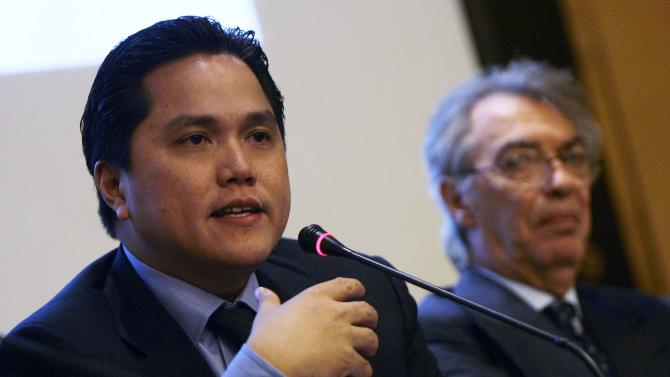 Inter Milan's chairman Thohir speaks as honorary chairman Moratti looks on during a news conference in Milan