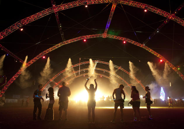 Carnival goers dance near the back of the crowd at one of six stages during the third day of the Electric Daisy Carnival, Sunday, June 26, 2011, in Las Vegas. (AP Photo/Julie Jacobson)