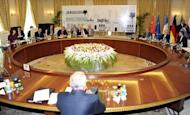 "File picture shows representatives of the P5+1 during a meeting with Iran's chief negotiator Saeed Jalili (R) in Baghdad on May 23. Tehran has ""no reason"" to suspend its enrichment of uranium to 20 percent, one of the key demands of world powers engaging Iran in talks, the head of its Atomic Energy Organisation said"