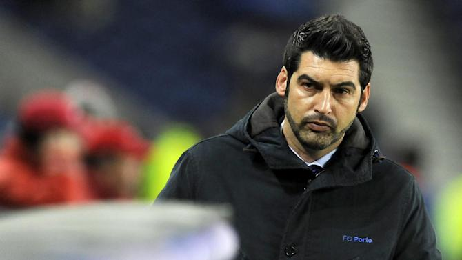 FC Porto's coach Paulo Fonseca walks towards his bench prior to their 1-0 defeat with Estoril in a Portuguese League soccer match at the Dragao stadium, in Porto, Portugal, Sunday, Feb. 23, 2014