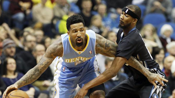 Denver Nuggets's Wilson Chandler, left, keeps the ball away from Minnesota Timberwolves' Corey Brewer in the first quarter of an NBA basketball game on Wednesday, Nov. 27, 2013, in Minneapolis