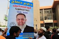 Egyptian Islamists hold up a poster bearing the portrait of Salafist presidential candidate Hazem Abu Ismail during a rally outside the State Council court in Cairo on April 10. Abu Ismail is out of the race because his mother holds another nationality, violating election rules which state that all candidates, their parents and their wives must have only Egyptian citizenship