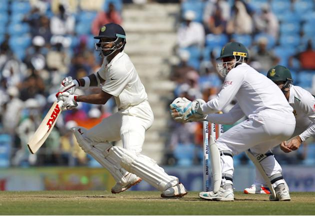 India's Dhawan plays a shot during the second day of their third test cricket match against South Africa in Nagpur