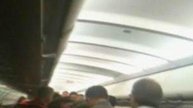 Caught On Video: Passengers Restrain Unruly Flier