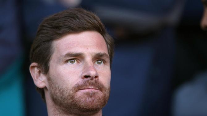 Andre Villas-Boas, pictured, says Luka Modric is making his situation worse at Tottenham