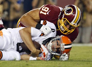 Ryan Kerrigan sacks Brian Hoyer. (AP)