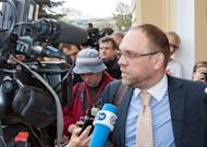 Serhiy Vlasenko, lawyer of Ukraine's ex-premier Yulia Tymoshenko, talks to journalists at the court building in Ukrainian city of Kharkiv prior to the trial opening on April 19. Vlasenko told AFP Tymoshenko has started a hunger strike in jail