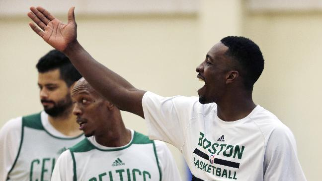 Boston Celtics forward Jeff Green jokes with teammates during their NBA basketball training camp at Salve Regina University, Wednesday, Oct. 2, 2013, in Newport, R.I
