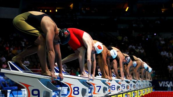 Ruby Martin (2nd L) gets set for the start on the block along with the rest of the field as they prepare to compete in preliminary heat 9 of the Women's 50 m Freestyle during Day Six of the 2012 U.S. Olympic Swimming Team Trials at CenturyLink Center on July 1, 2012 in Omaha, Nebraska. (Photo by Al Bello/Getty Images)