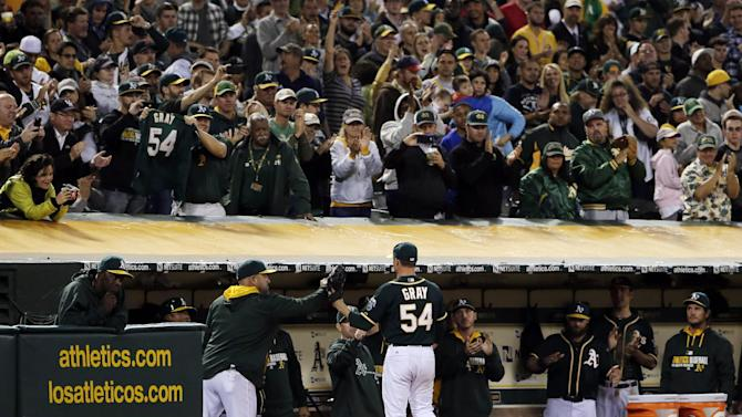 Gray pitches into 9th, A's top Angels