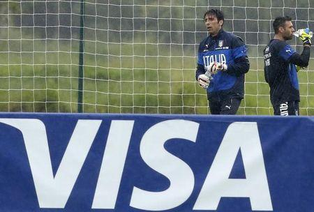 A Visa advertising banner is pictured as Italy's national soccer goalkeepers Buffon and Sirigu drink during a training session ahead of the 2014 World Cup in Mangaratiba
