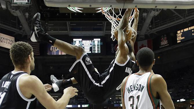 Brooklyn Nets' Andray Blatche dunks during the first half of an NBA basketball game against the Milwaukee Bucks Saturday, Dec. 7, 2013, in Milwaukee